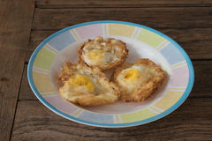 Fried egg. Crispy fried egg on a wooden table Royalty Free Stock Photography