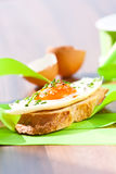 Fried egg crostini Stock Images