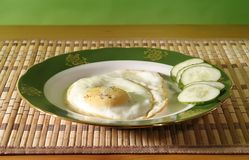 Fried egg and cucumber Royalty Free Stock Photos