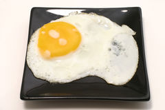 Fried egg on dish Royalty Free Stock Images