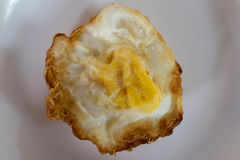 Fried egg. S on a plate on a white background Stock Photos