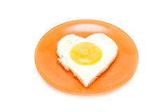 Fried egg in form heart Royalty Free Stock Photo
