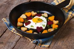 Fried egg in form heart and hearts, carrots, beets and potatoes Stock Photography