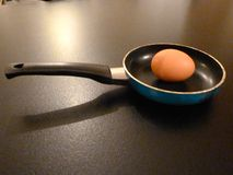 Fried egg. Fresh brown hens egg in a mini frying pan Stock Photography