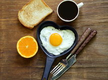 Fried egg with fresh orange, toast and coffee Royalty Free Stock Photography