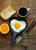 Fried egg with fresh orange, toast and coffee Stock Photography