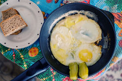 Fried egg in a frying. Pan on a wooden table stock photography