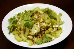 Fried egg gourd. Was Yummy on white dish and brown background Stock Images