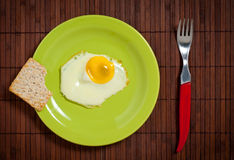 Fried egg in green plate Royalty Free Stock Image