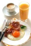 Fried egg with ham Stock Photos
