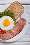 Fried egg with ham and toast. Close-up. Stock Photos
