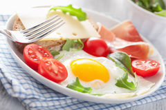 Fried egg ham tomatoes for healthy breakfast Stock Photography