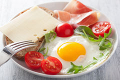 Fried egg ham tomatoes for healthy breakfast Stock Photo