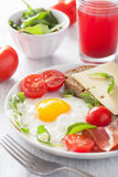 Fried egg ham tomatoes for healthy breakfast Stock Image