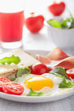 Fried egg ham tomatoes for healthy breakfast Stock Images