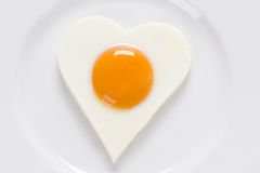 Fried egg in a heart shape Royalty Free Stock Photography