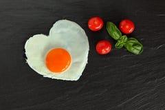 Fried egg in heart shape Stock Photo