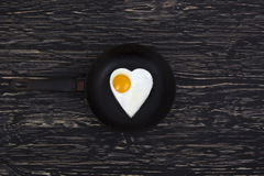 Fried egg Heart shape on the pan Royalty Free Stock Photo