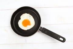 Fried egg heart-shaped Stock Image