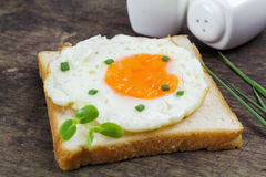 Fried egg heart-shaped Stock Images