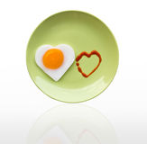Fried egg heart and source heart Royalty Free Stock Photos