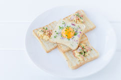 Fried egg inside toast, scrambled eggs Stock Images