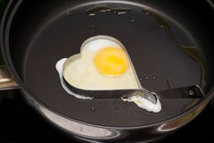 Fried egg in iron form heart Stock Image