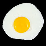 Fried egg. Isolated on a black background Stock Photos