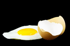 Fried egg. Isolated on a black background Stock Photography