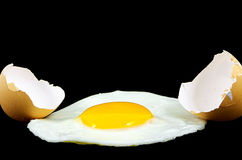 Fried egg. Isolated on a black background Stock Images