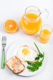 Fried egg and a jug of orange juice Royalty Free Stock Photography