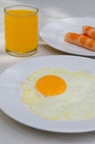 Fried egg and juice Stock Photo
