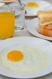 Fried egg and juice Stock Photography
