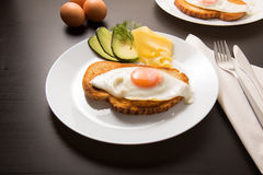 Fried egg with knife and fork. On white towel Royalty Free Stock Images