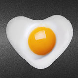 Fried egg like heart Stock Images
