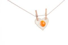 Fried egg love heart stock image