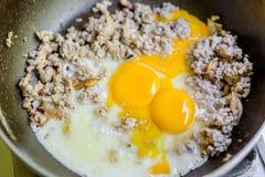 Fried egg with minced pork Stock Photos