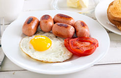 Fried egg, mini sausages Stock Photography