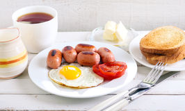 Fried egg, mini sausages Royalty Free Stock Photo