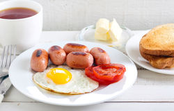 Fried egg, mini sausages, Royalty Free Stock Images