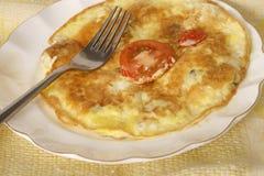 Fried egg omlet with tomato Stock Photos
