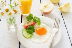 Fried egg and orange juice Stock Photo