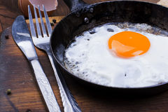 Fried egg on pan. Stock Image