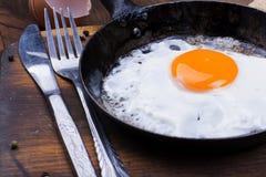 Fried egg on pan. Stock Image