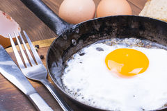Fried egg on pan. Stock Photo