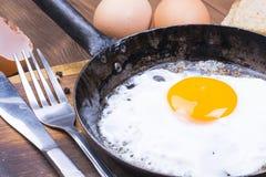 Fried egg on pan. Stock Photo
