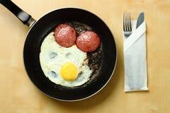 Fried egg on pan. Stock Photos