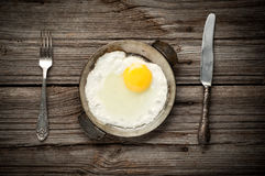 Fried egg on a pan served Stock Photography