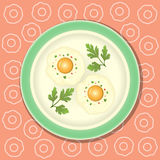 Fried egg with parsley on the plate Royalty Free Stock Photos