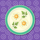 Fried egg with parsley on the plate Stock Photos